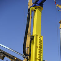 e-chain® installed hanging in a construction machine